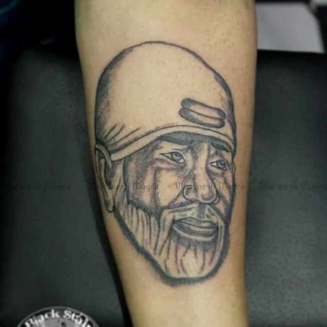 Nice Face Of Sai Baba Tattoo