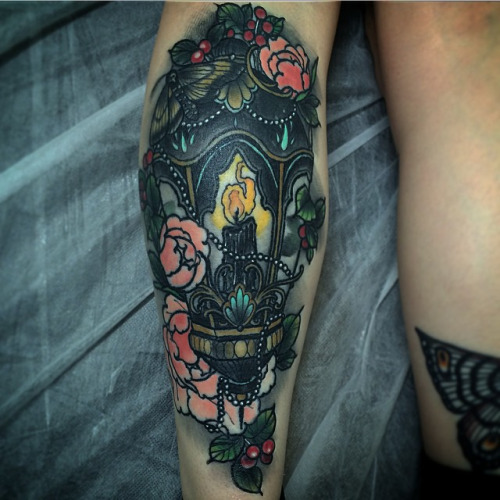 Nice Flower Lantern Burning Candle Tattoo On Sleeve