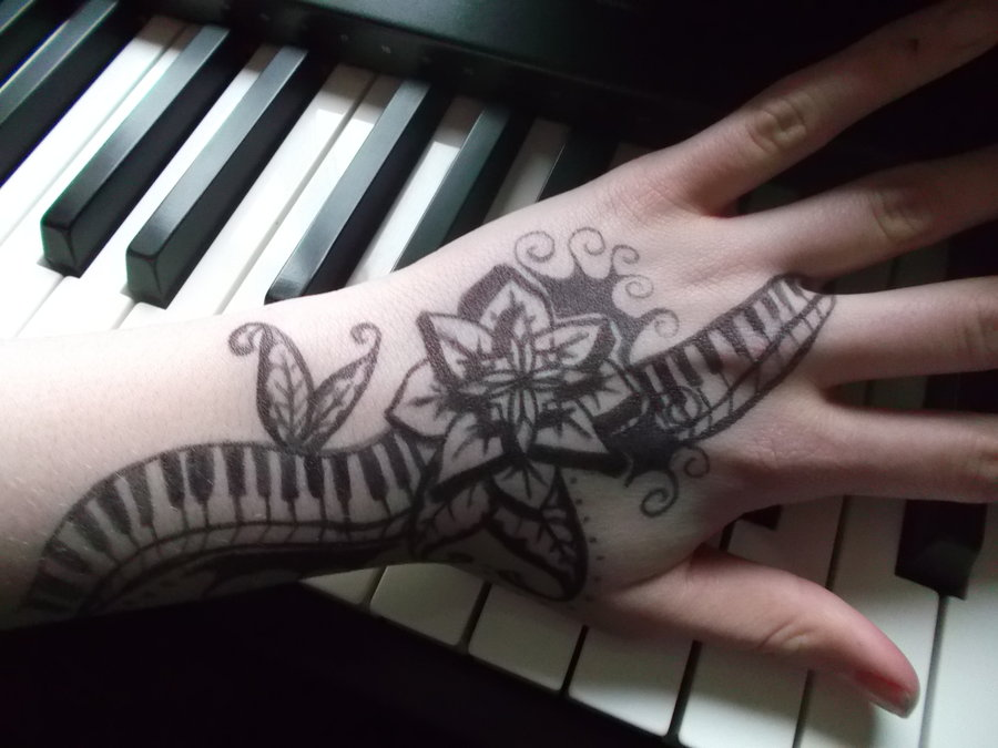 Nice Flower With Simple Piano Keys Tattoo Design Idea On Hand