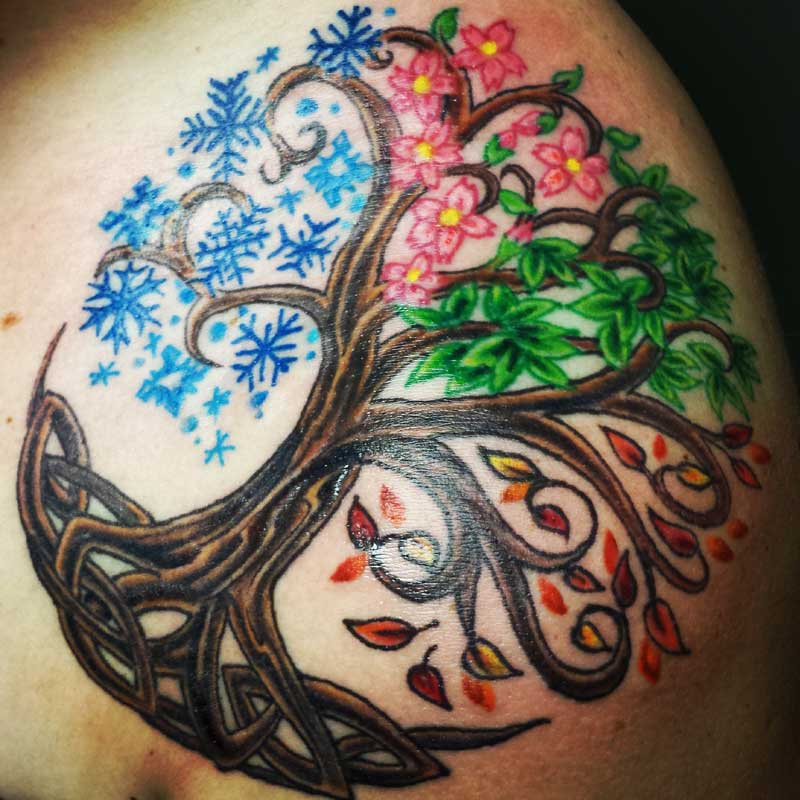 Nice Flowers With Celtic Pegan Tree Tattoo On Men Shoulder
