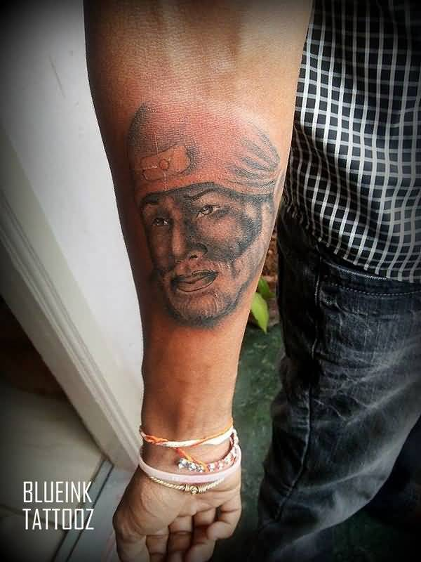 Nice Forearm Lower Sleeve Sai Baba Face Tattoo