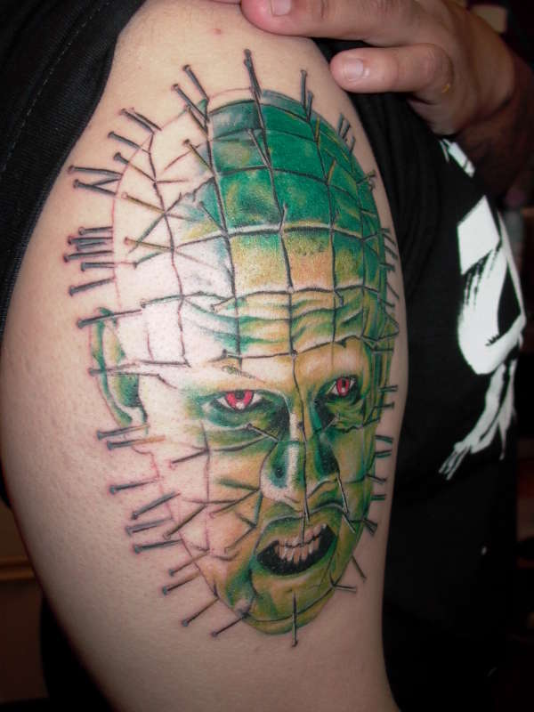 Nice Green Ink Angry Pinhead Tattoo Design Idea On Half Sleeve