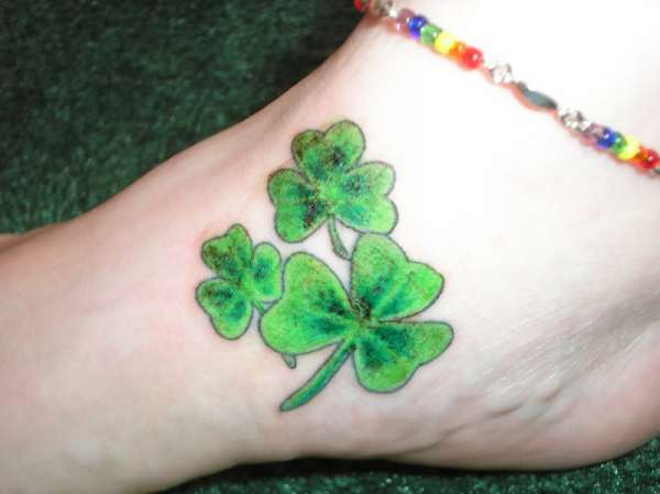 Nice Green Ink Nice And Amazing Shamrock Tattoo Design Idea On Foot