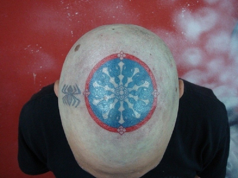 Nice Head With Scarification Symbol Tattoo Idea