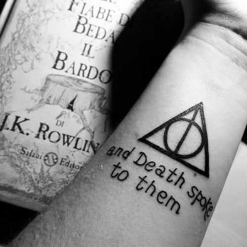 Nice Letters Amazing Hallows Tattoo On Wrist