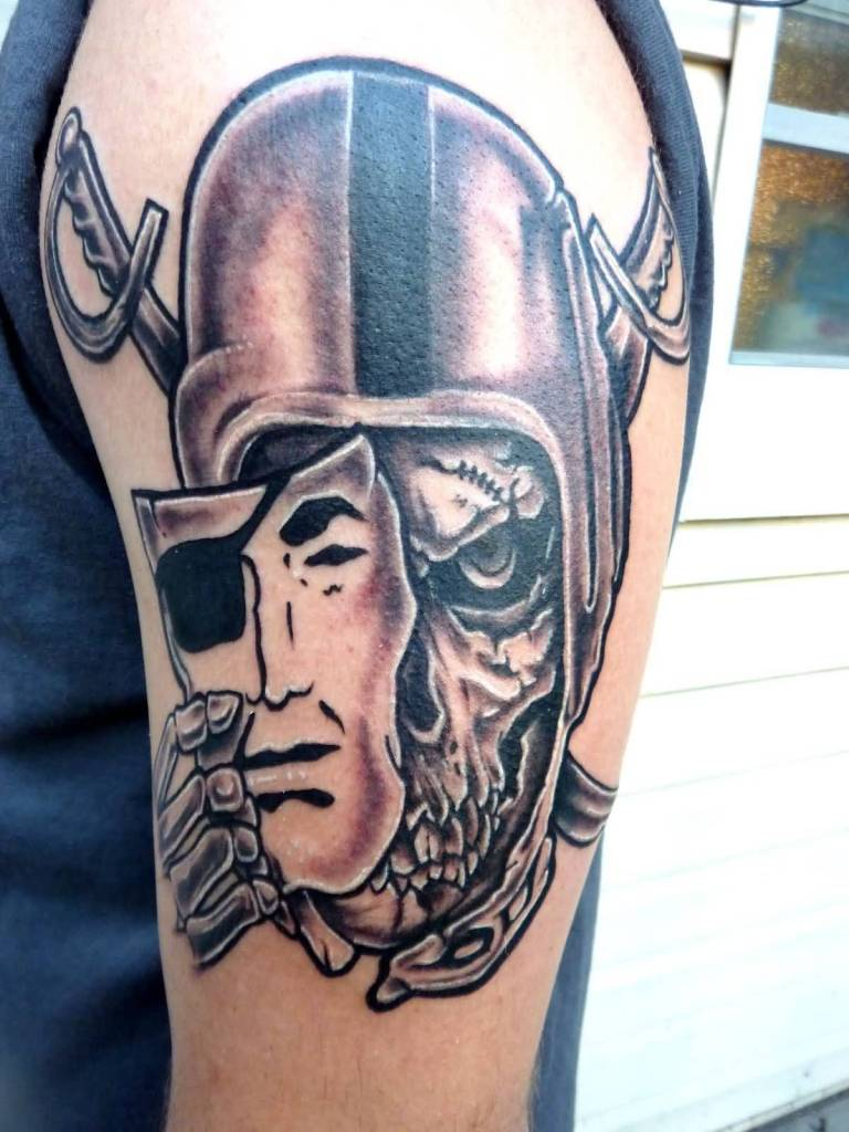 Nice Mask With Amazing Oakland Raiders Skull Tattoo On Upper Sleeve