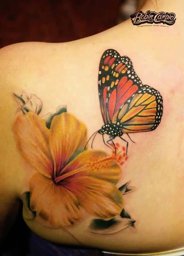 Nice Monarch Butterfly On Orange Flower Tattoo On Upper Back