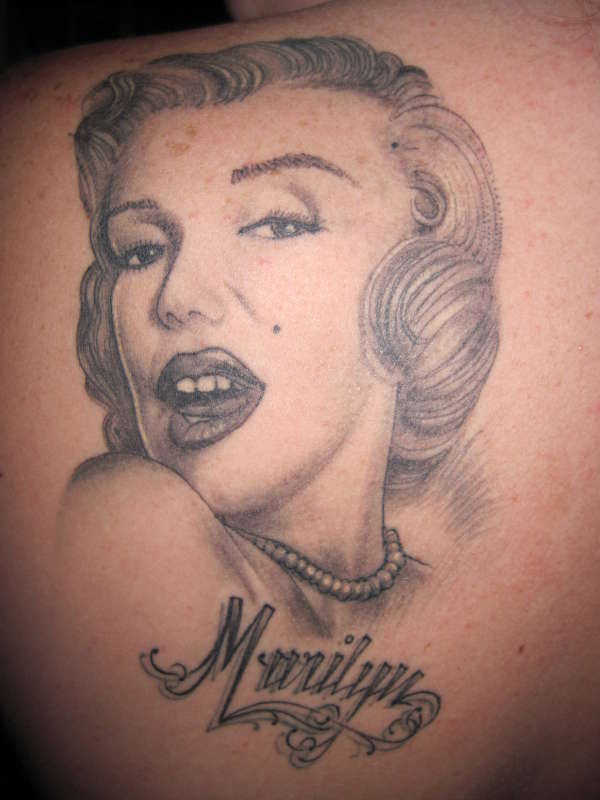 Nice Name With Marilyn Monroe Face Tattoo On Upper Back