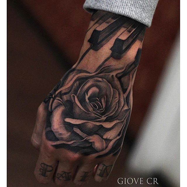 Nice Piano Keys With Real Look Rose Flower Tattoo