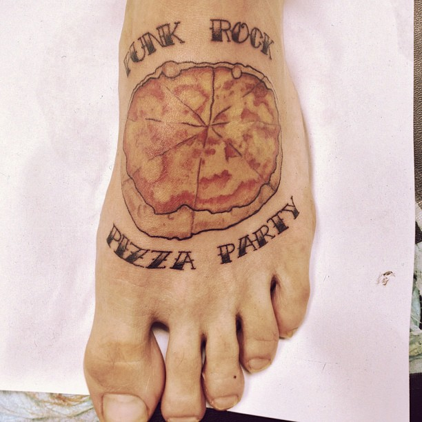 Nice Pizza Tattoo With Text On Foot