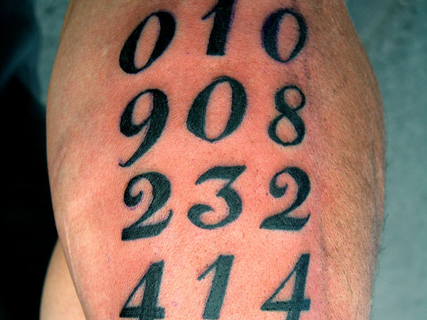 Nice Randow Row Numbers Tattoo Design By Black Ink