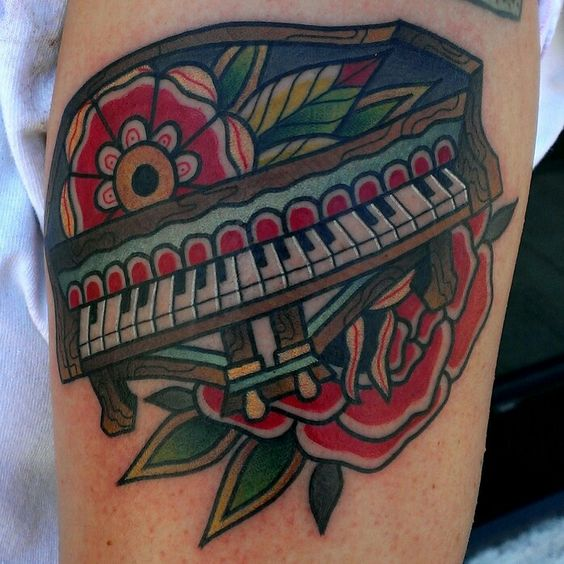Nice Red Rose With Amazing Piano Tattoo
