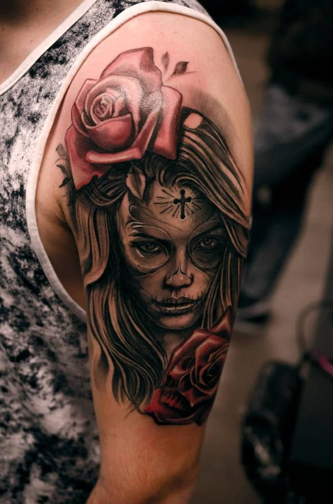 Nice Red Rose With Catrina Girl Face Tattoo On Upper Sleeve