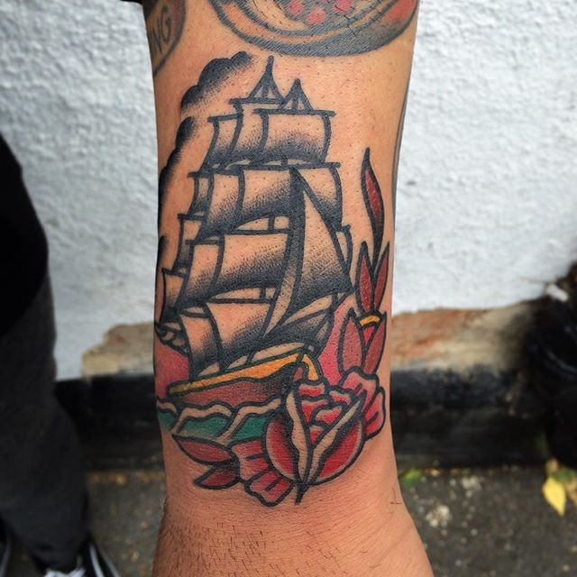 Nice Red Rose With Nice Old School Pirate Ship Arm Sleeve Tattoo
