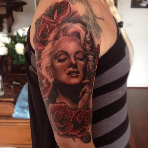 Nice Red Roses Flower With Nice Marilyn Monroe Face Tattoo Design Idea On Half Sleeve