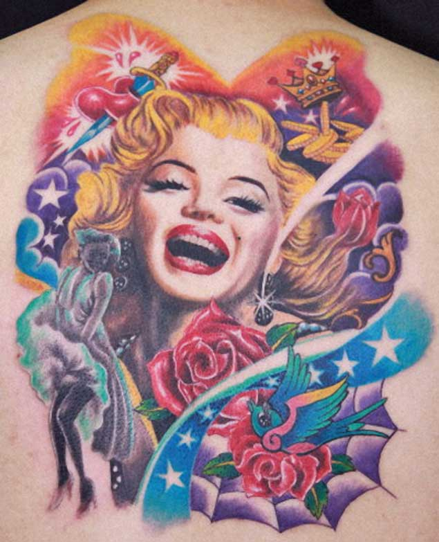 Nice Red Roses With Awesome Marilyn Monroe And Swallow Tattoo