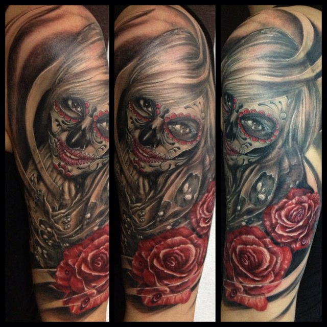 Nice Red Roses With Smiling Catrina Tattoo On Half Sleeve