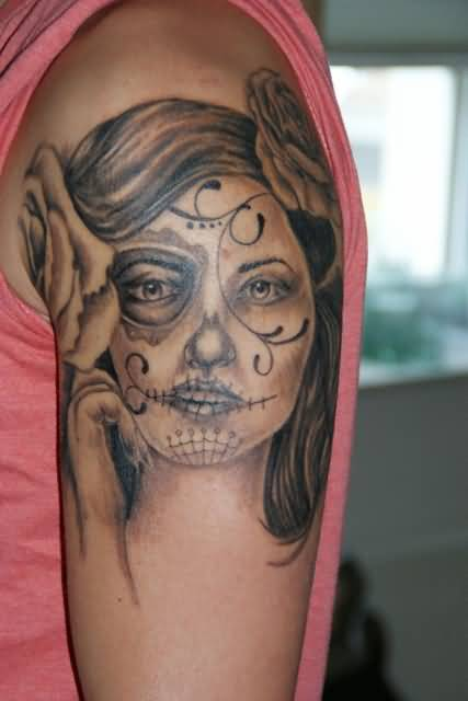 Nice Rose Flower With Simple Catrina Tattoo On Upper Sleeve