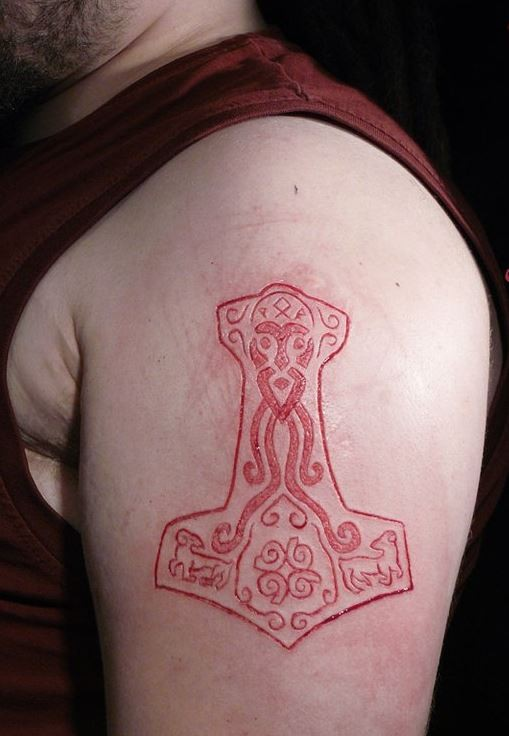 Nice Scarification Tattoo Of Nice Anchor On Shoulder