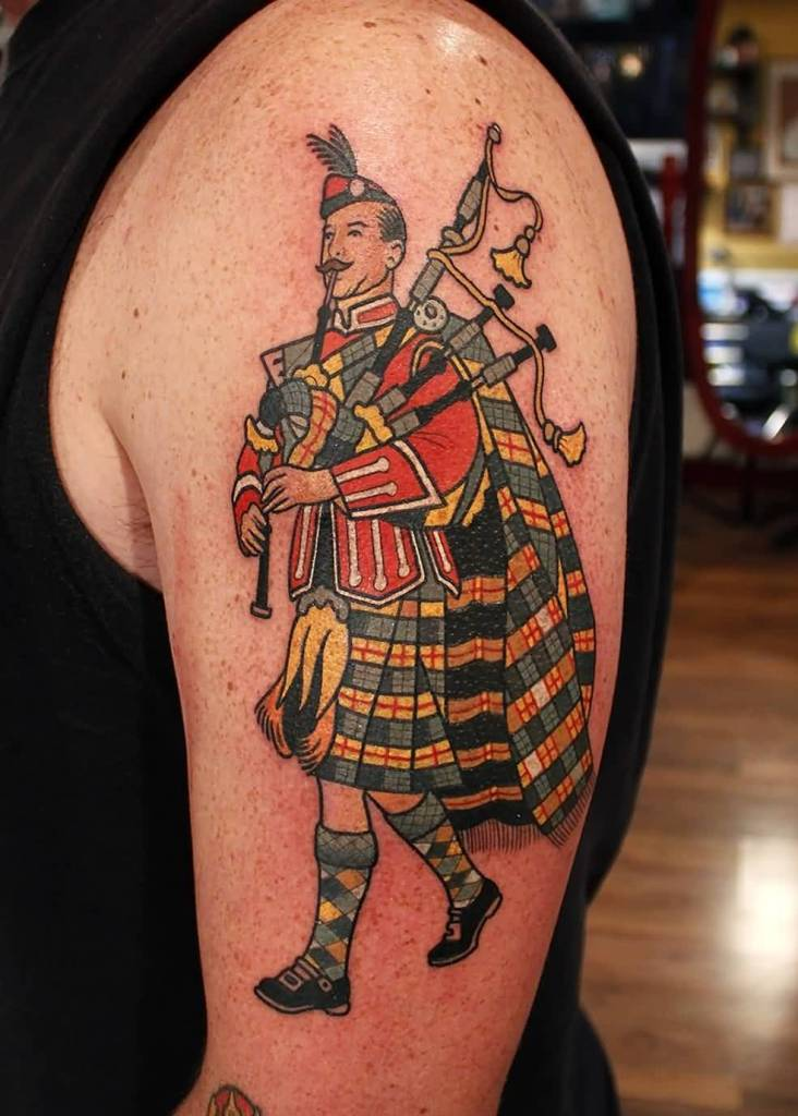 Nice Scottish Bagpipe Player Tattoo Design On Left Shoulder
