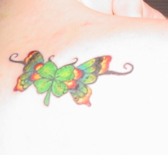 Nice Shamrock In Butterfly Wings Tattoo