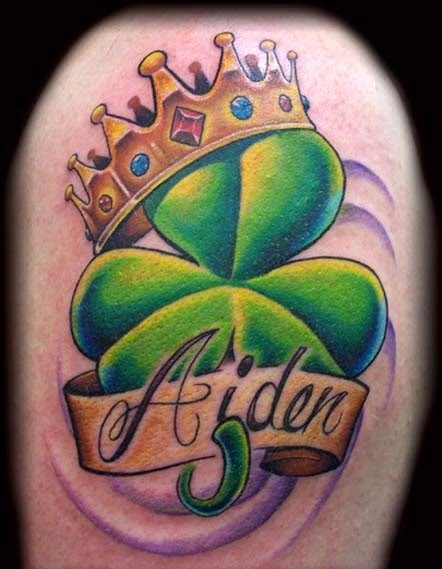 Nice Shamrock With Name Banner Crown Tattoo On Shoulder
