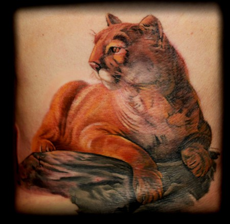 Nice Sitting Pose Wonderful Puma Tattoo
