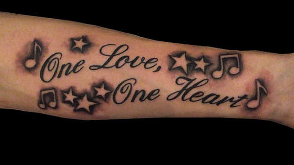 Nice Stars Music Notes Amazing Love Heart Tattoo On Forearm