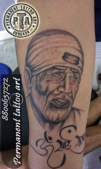 Nice Text And Sai Baba God Tattoo