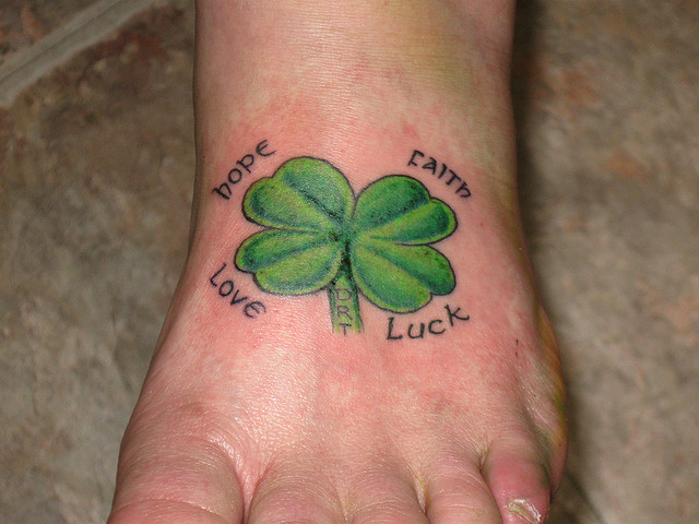 Nice Text With Amazing Shamrock Tattoo Design Idea On Foot