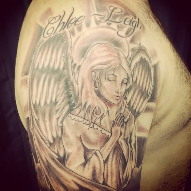 Nice Text With Sweet Praying Angel Tattoo On Men Shoulder