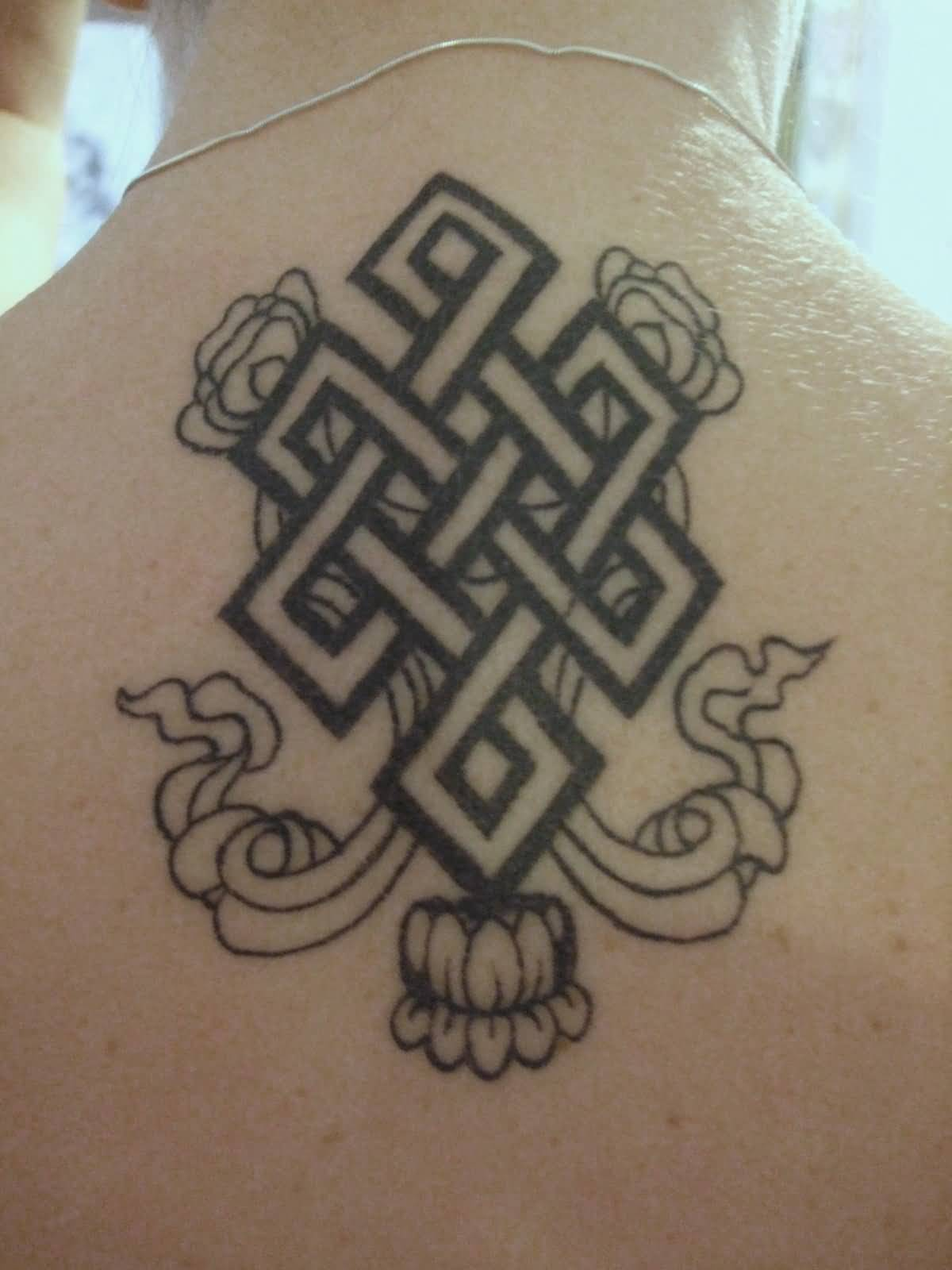 Nice Upper Back Small Lotus Flower Endless Knot Tattoo