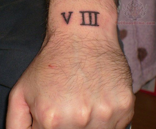 Nice Upper Wrist Roman Numbers Tattoo For Men