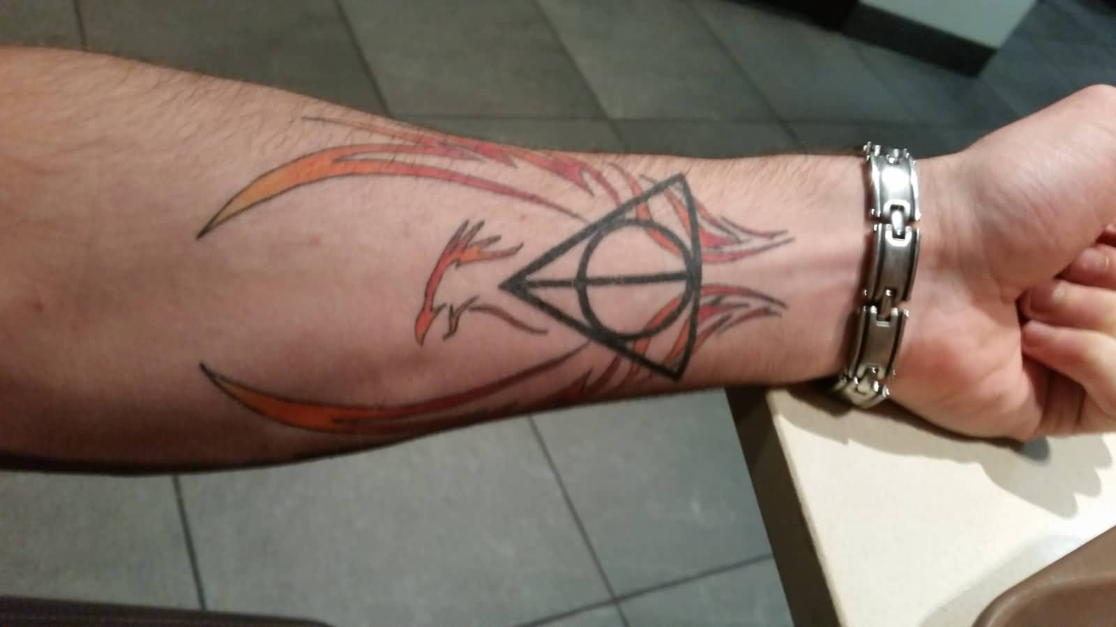 Nice Wings Amazing Hallows Tattoo On forearm