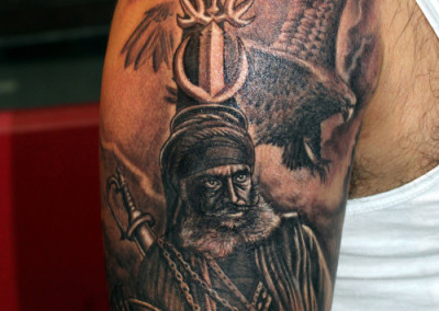 Nihang Angry Punjabi Sikh Warrior Face Tattoo On Shoulder