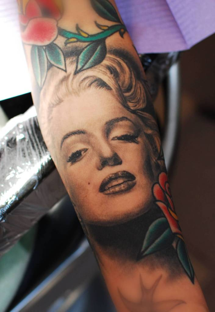 Old School Red Roses And Nice Marilyn Monroe Portrait Face Tattoo