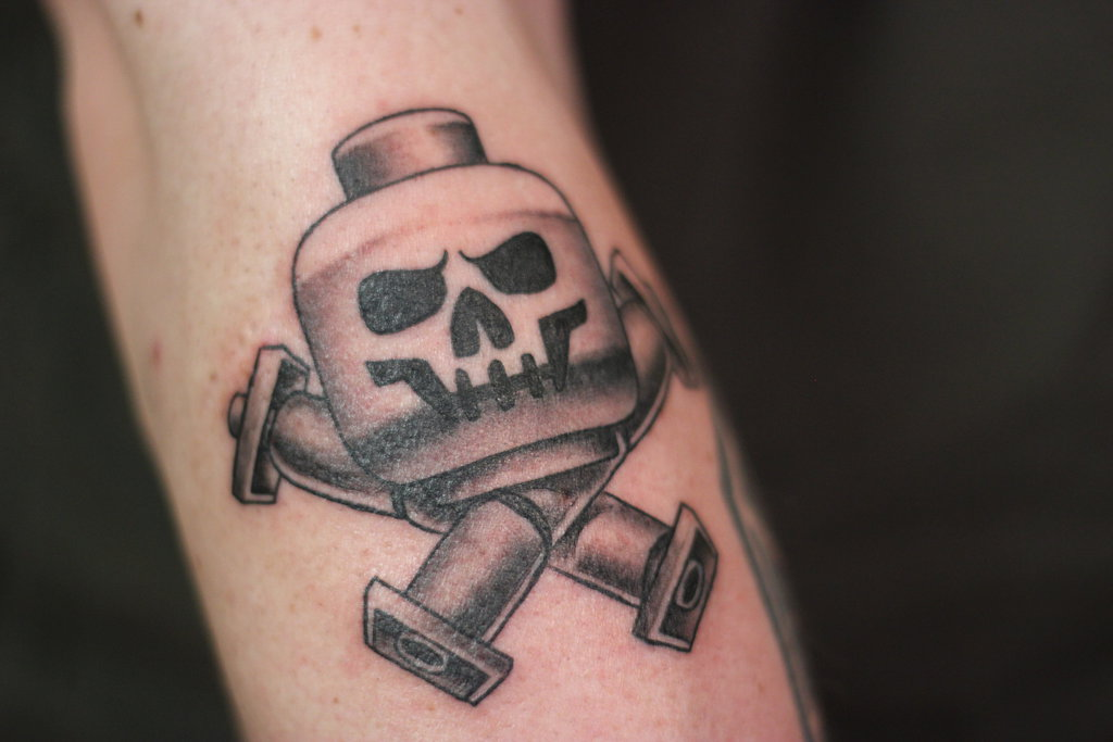 Old Staff Simple Jolly Roger Tattoo Design