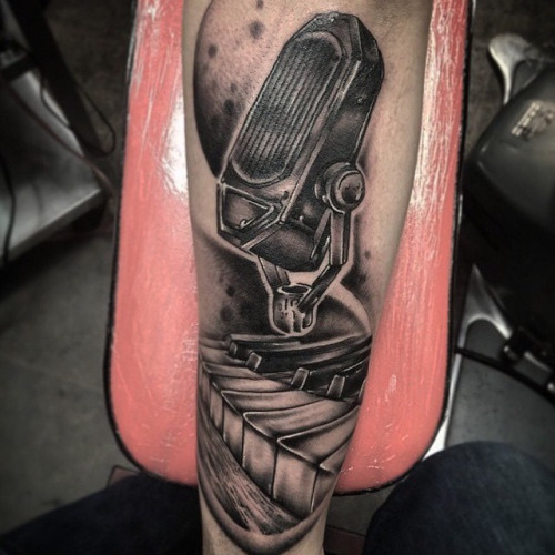 Old Trend Microphone With Nice Grey Ink Piano Keys Tattoo