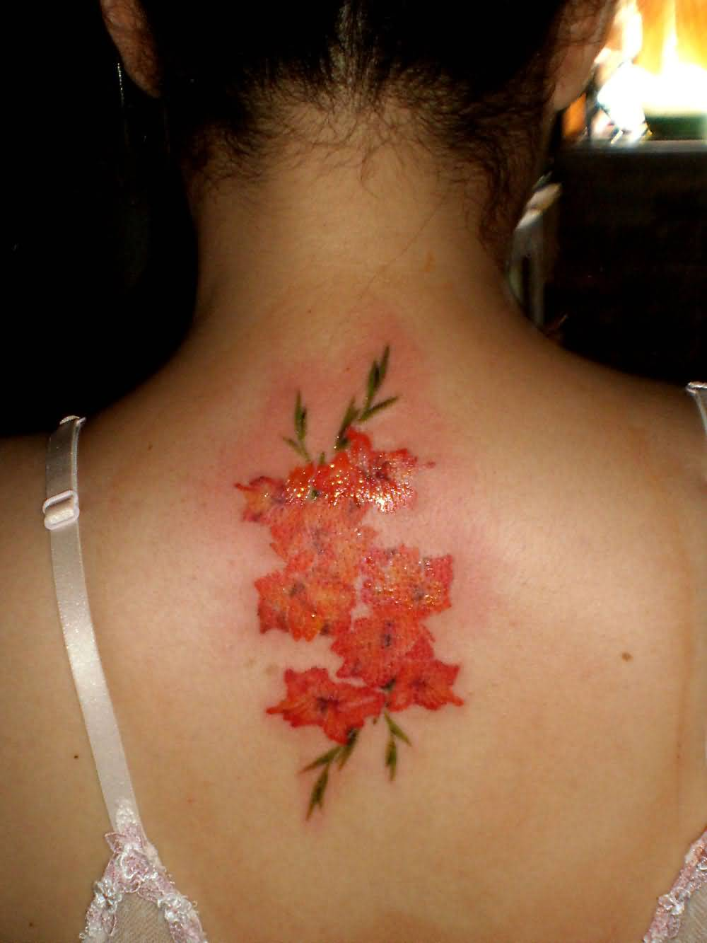 Orange Realistic Gladiolus Flower Tattoo Design Idea On Upper Back