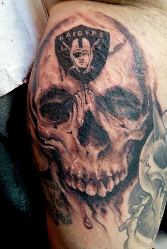 Outstanding And Classy Oakland Raiders Skull Logo Tattoo
