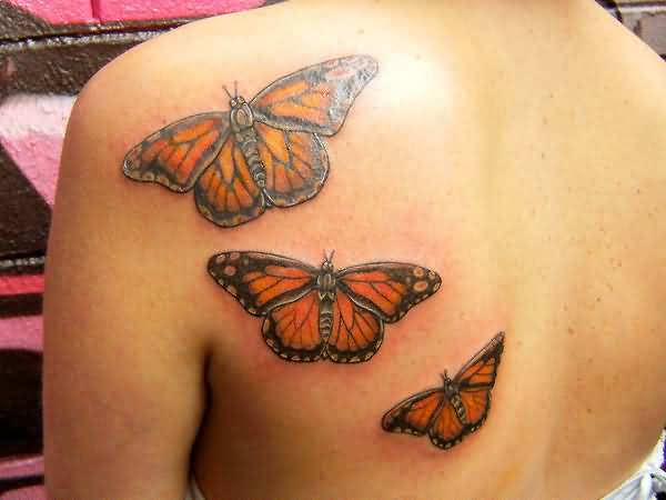 Outstanding Classy Cool Flying Monarch Butterfly Tattoo On Upper Back