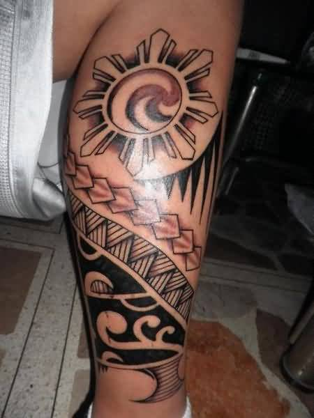 Outstanding Tribal With Filipino Sun Tattoo Design On Leg