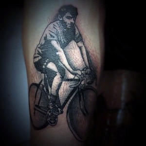 Painted  Black And White Man Riding On Amazing Bicycle Tattoo