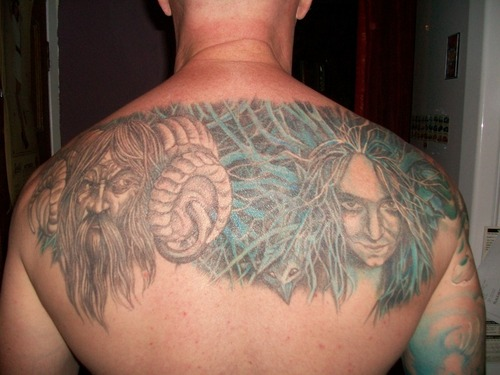 Pegan God Face Tattoo On Men Upper Back