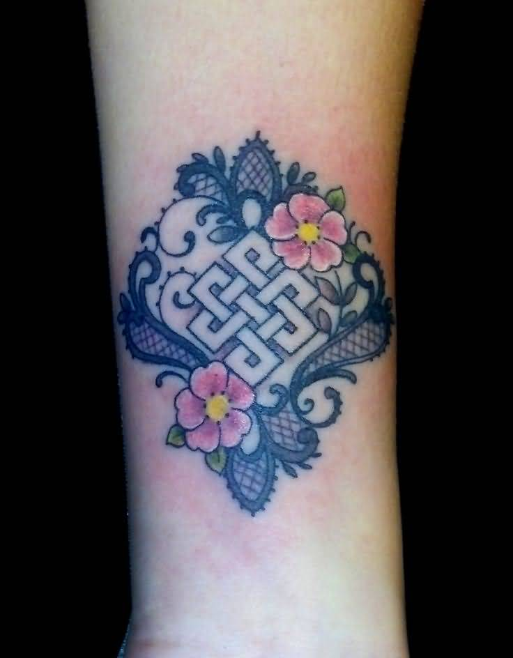 Pink Flower With Endless Knot Tattoo On Wrist