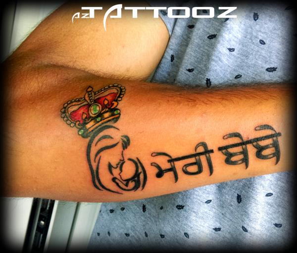 Queen Meri Bebe Punjabi Font Tattoo On Lower Arm