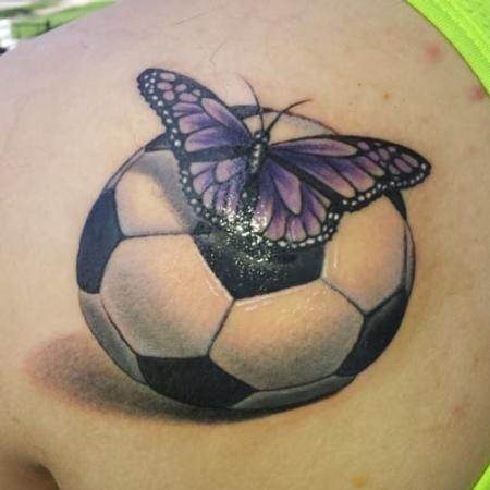 Realistic Football And Butterfly Tattoo On Upper Back