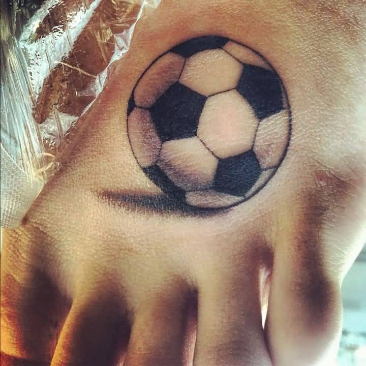 Realistic Football Tattoo On Girl Foot