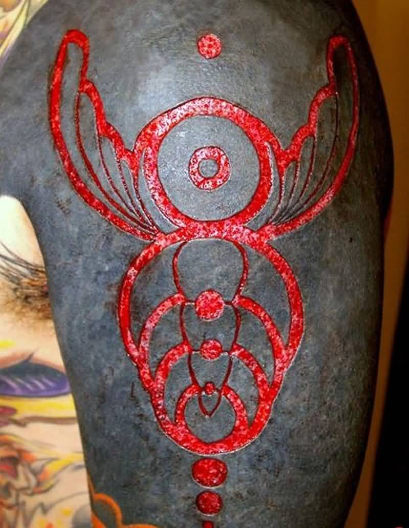 Red Dark Ink Amazing Scarification Tattoo Design Idea On Shoulder