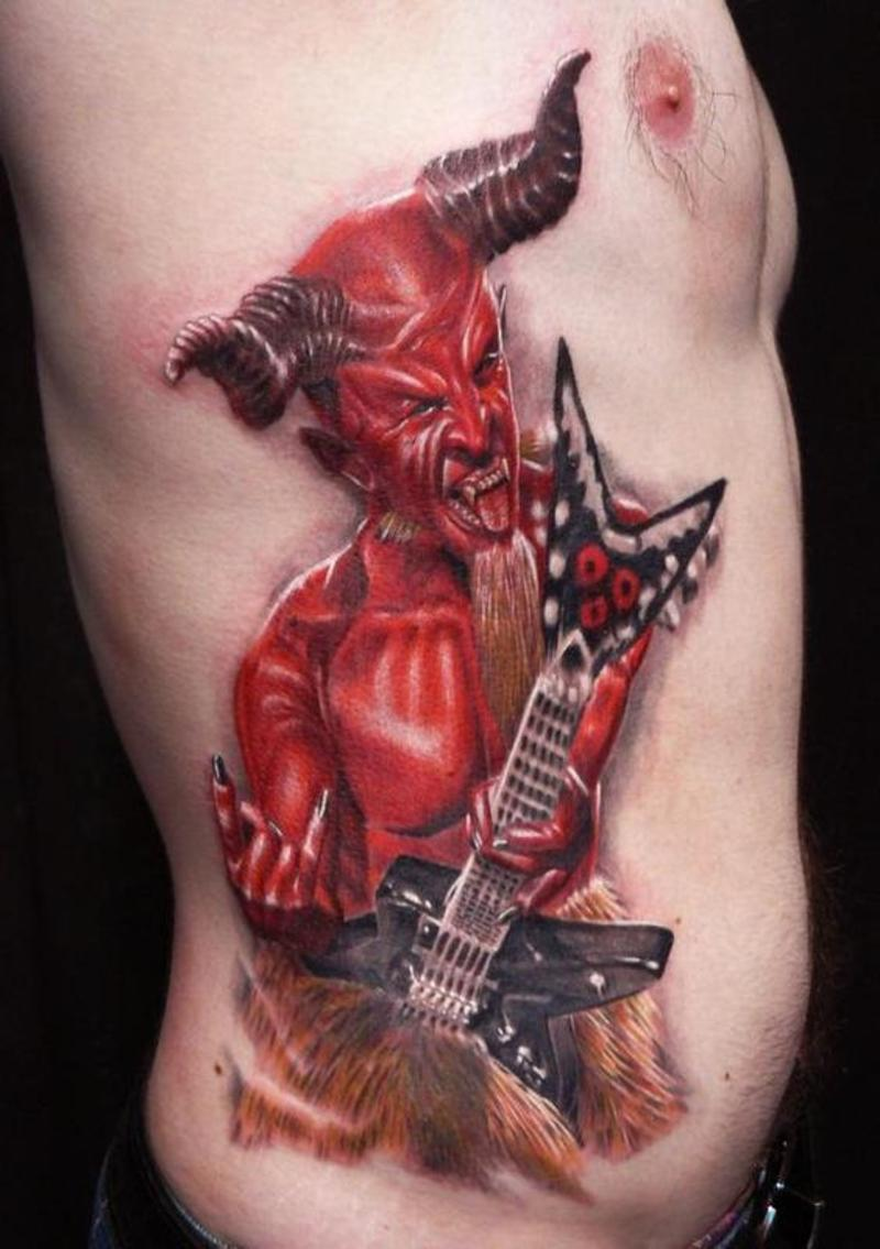 Red Ink Aggressive And Dangerous Satan With Guitar Tattoo Make On Men Rib Side